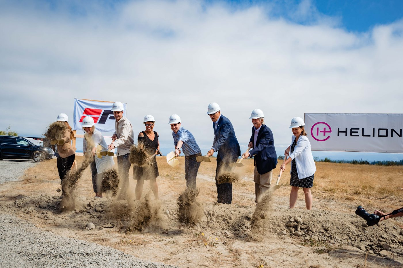 Helion and elected officials breaking ground in front of Helion sign